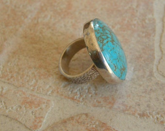 Hand Made Sterling Silver Ring With A Turquoise Stone Center