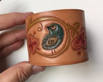 Folk art bird leather cuff