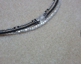 Beautiful braclet with swarovski Crystal.  Black  and white and silver