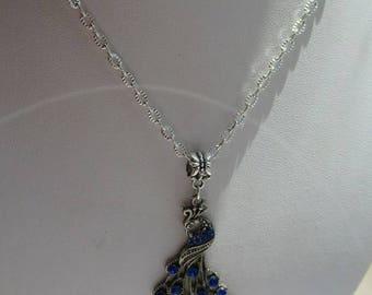 COLLIER  PENDENTIF PAON argenté avec zircons bleus marines magnifique bijou a s'offrir