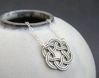 silver celtic necklace. small sterling silver circle necklace. braided knot pendant. simple. oxidized. blackened. rustic. antiqued jewelry
