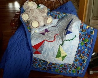 Kites and fish blue crib quilt