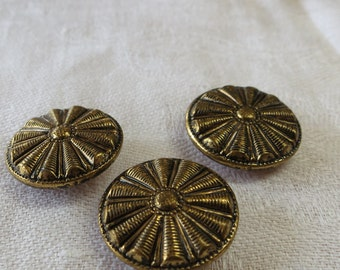 "3 Vintage 2 part metal buttons. 0.75""ins across, set of 3, with  coiled cone central design, brass toned. Very good condition. UNK18.4-17.3."