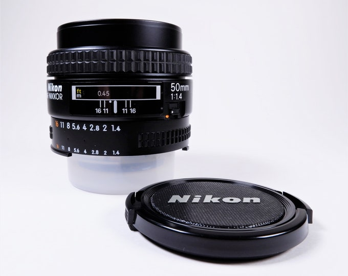 Nikon AF Nikkor 50mm f1.4 Lens with Nikon Front & Rear Caps - Mint Condition - Made in Japan - 7 Elements in 6 Groups - Slide Aperture Lock