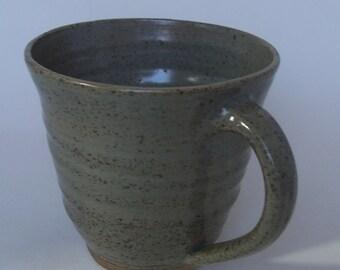 Stoneware coffee mug, tea cup. With celadon green glaze.