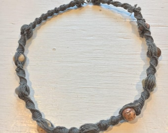 Grey hemp necklace with brown, grey, and cream colored stone beads