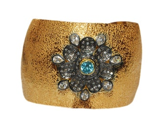 92.5 % Silver cuff/bangle with designer cubic zirconia blue topaz stone work with gold plated.