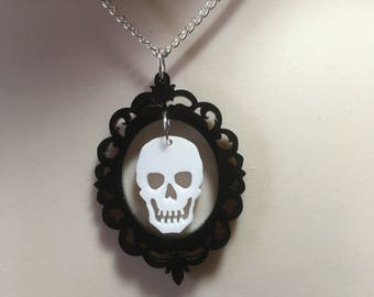 Dramatic hanging skull in a gothic frame pendant