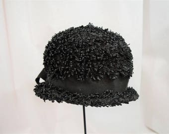 Vintage 1960s black cellophane straw raffia cloche bucket top hat with ribbon trim