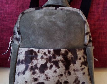 Suede leather backpack with pony pocket at the front
