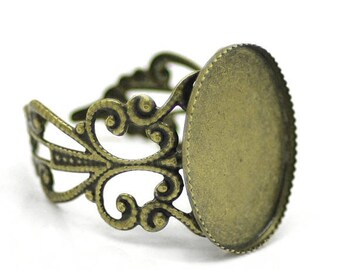 5 supports filigree ring in bronze color metal, oval 13x18mm
