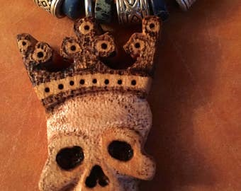 Handcarved, skull king necklace.