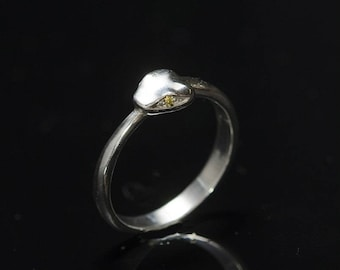 Elegant female snake ring in the form of sterling silver with zircon yellow eyes instead. The symbol of infinity.