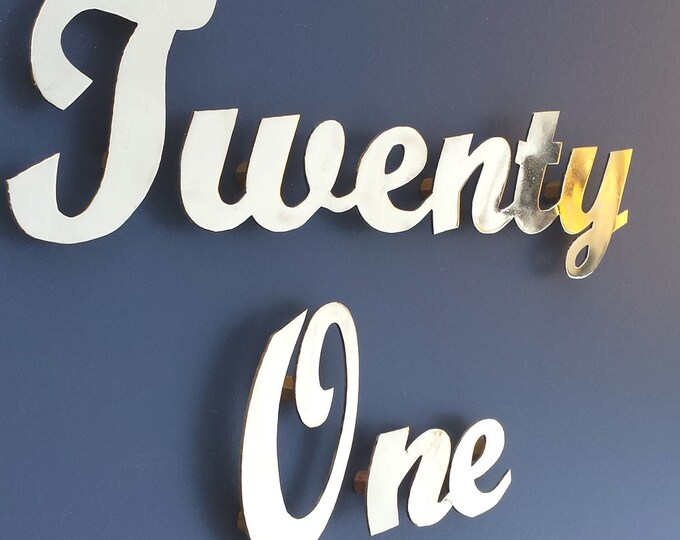 "Brass Script House name or number  3""/75mm high, sign locators for easy installation"