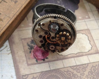 Steampunk flower ring,  resin coated watch movement inside Vintage mainspring case Handcrafted artistic jewelry -The Victorian Magpie