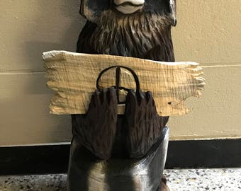 Chainsaw Carved Raccoon With Sign