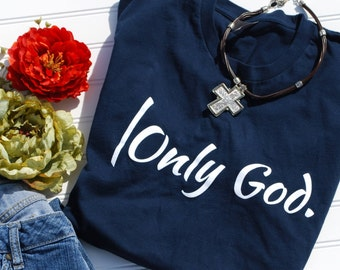 Soft, faith t shirts.  |Only God. is a design that is guaranteed to share your faith!  Navy blue, fitted t-shirt, true to size.