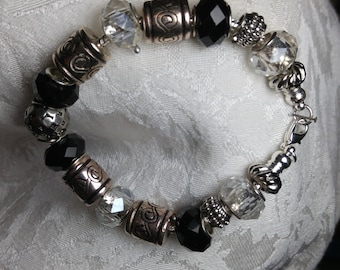 Afternoon: Large black & clear glass beads w/a variety of silvertone spacers on silvertone nickel free chain,claw clasp. SimplyElegantKathy