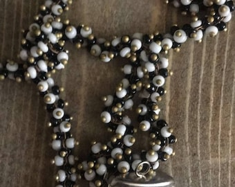 Long Black and White Seed Necklace with White Claw
