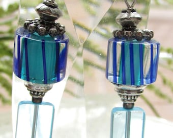 Blue striped barrel beaded glass earrings with solid blue glass and metal trim