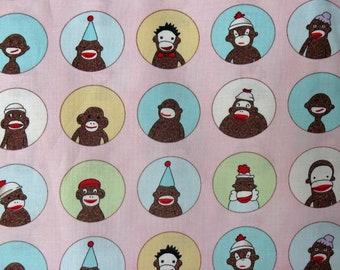 Monkeys'N Round Pink sock monkey fabric