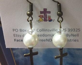 Cross and pearl earrings