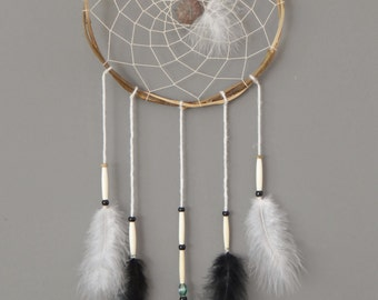 dream catcher made of wood with stone