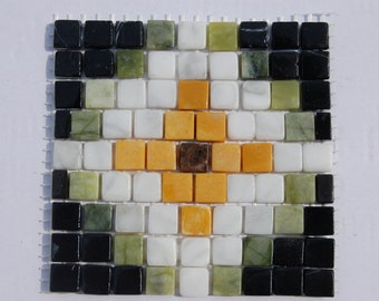 Marble pieces on pattern glued on net, tile for decoration on wall
