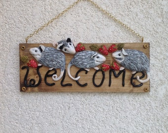 Opossums and strawberries welcome sign