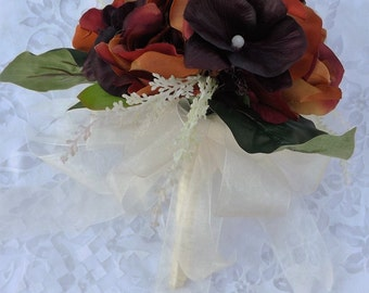 wedding bouquet in piones mocca brown and orchiids brown