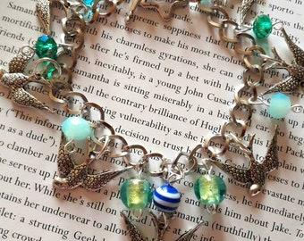 Rockabilly swallows charm bracelet