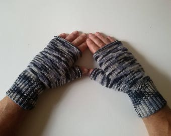 Mittens with thumbs knitted men's hands