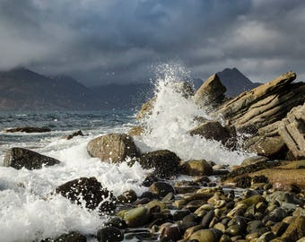 This is a photographic print of water crashing up the rocks in Elgol, Scotland.