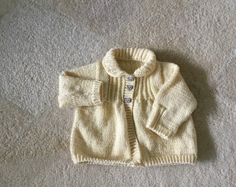 Hand knitted baby smocked vintage style coat