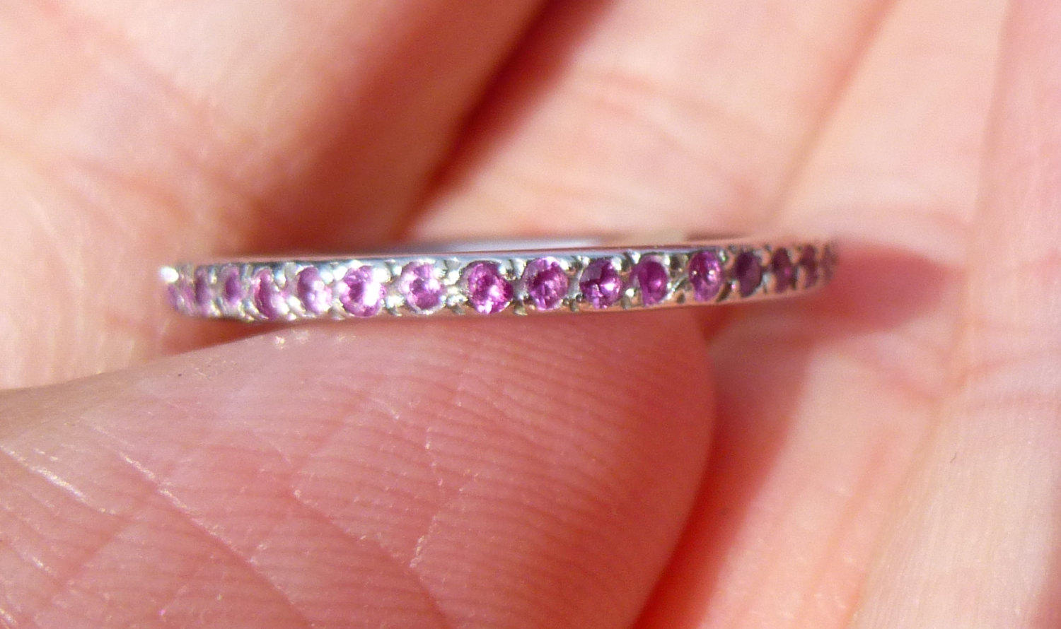Eternity band in platinum with Natural Rubys all the way
