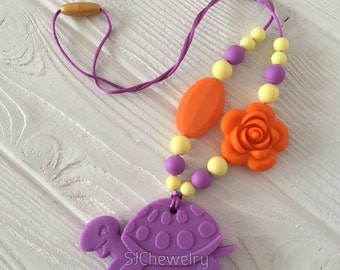 Teething necklace with a turtle shaped silicone pendant