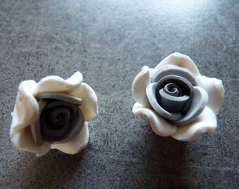 2 gray and white polymer clay flowers