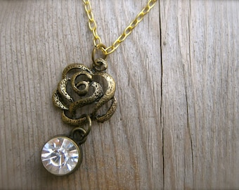 Necklace Crystal Drop Pendant Rose Necklace. Rhinestone and Brass Rose Charm Necklace. Antiqued Brass and Gold Chain Necklace.