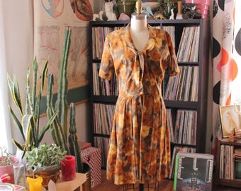 """vintage 1960s fit and flare dress with tie collar . pleated skirt shirtdress w/ watercolor floral print . womens large, 31"""" waist"""