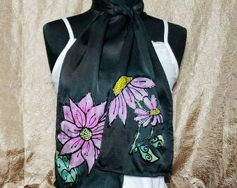 Silk charmeuse scarf measures 8 inches wide by 54 inches long.
