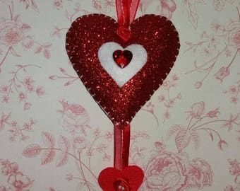 Red hanging heart decoration. Heart decoration.