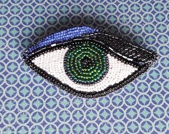 Eye bead brooch