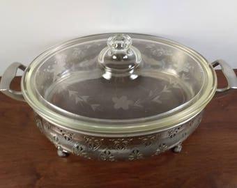 Antique pyrex and casserole holder Forman & Lerner, Inc. Circa 1919-1925 Engraved Pyrex Casserole with Lid Corning Glass Works