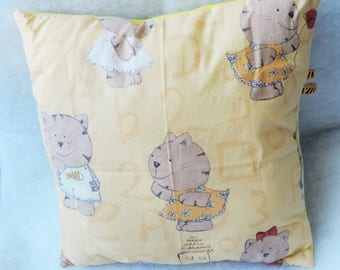 cushion blanket yellow fabric has small cat