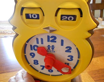 Vintage Tomy learning toy.  Clock toy.