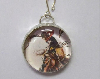 Chunky Round Glass Pendant with a Cowboy on a Bronc