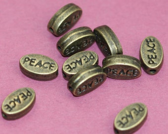 10 pcs of antiqued brass flat oval beads with 'Peace'  8x11mm
