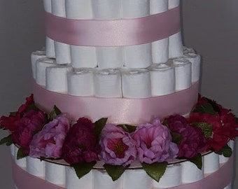 Elegant floral diaper cake in shades of pink. A stunning center piece for any baby shower, the mom-to-be will be ecstatic!