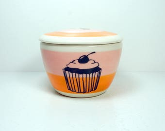 a lidded bowl / jar with a Cupcake print shown here on a color block of bubblegum pink & creamsicle orange READY TO SHIP