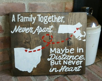 State to State A family together never apart maybe in distance but never in heart wood sign